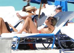 http://img125.imagevenue.com/loc442/th_260240102_lauren_stoner_bikini_topless_march19_2012_46_123_442lo.jpg